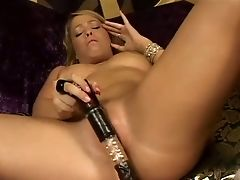 Buxom Towheaded Haired Housewife Lies On Sofa And Pleases Her Kitty With Giant Fake Penis