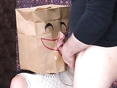 Pervy Pervert In Mask Fucks Mouth Of Mischievous Chick With Bag On Head